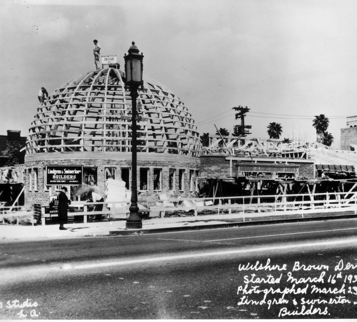 Brown Derby Restaurant Under Construction On Wilshire Blvd. The Brown Derby was the name of a chain of restaurants in Los Angeles, California. The first and most famous of these was shaped like a man's derby hat, an iconic image that became synonymous with the Golden Age of Hollywood. Opened in 1926, the original restaurant at 3427 Wilshire Boulevard remains the most famous due to its distinctive shape.