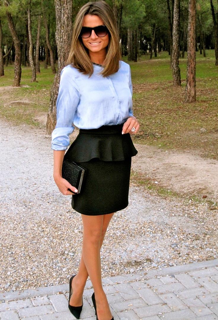 Blue blouse, black peplum skirt.