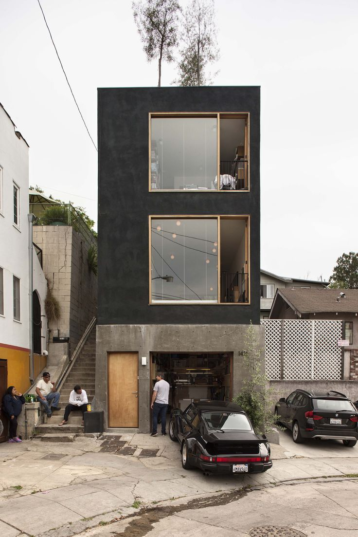 Simon Storey's Los Angeles home sits on a slim 4.5 metre-wide site. The garage becomes a workspace when he takes his car out onto the footpath.