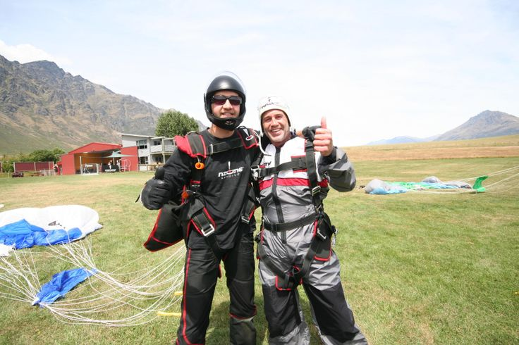 NZ TV Presenter and former rugby player Marc Ellis celebrated landing his skydive with Tandem Master Nick.