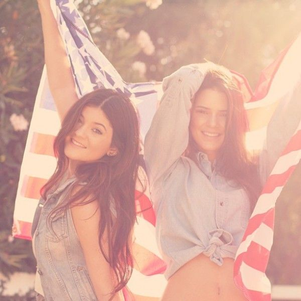 Kendall and Kylie Jenner Pose with American Flag