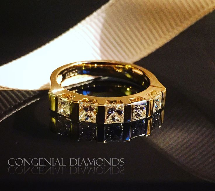 Contemporary five stone ring set with princess cut diamonds in 18ct yellow gold