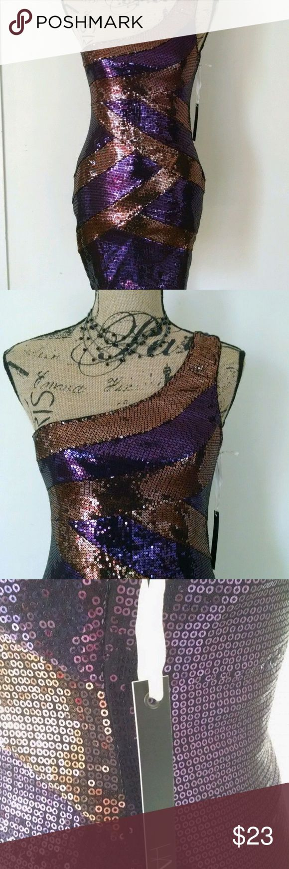 "New Sexy Sequins Tunic Dress Club Large Sexy Sequins Tunic Dress Club Vixen Vegas Prom Mini NWT Purple Bronze Sz Large  What a dress! Sequins highlight this dress throughout. It has one thick strap. It is new with tags. It is a size small with the following dimensions-Chest (armpit to armpit) 16"", Length 33"", Waist 13"", Hips 16"". Have Dresses Midi"