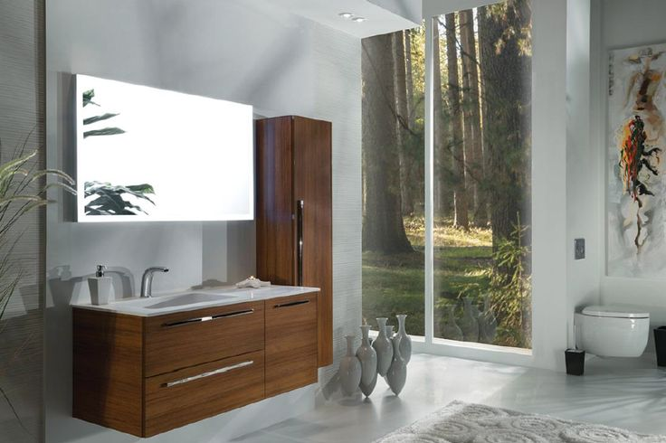 A light teak wood floating vanity with matching cabinet complements the in-wall toilet system in this eco-friendly bathroom.