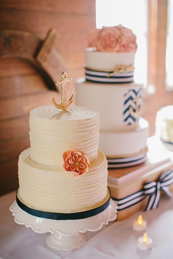 nautical #wedding cakes in ivory, gold and navy blue with blush pink flowers and anchors