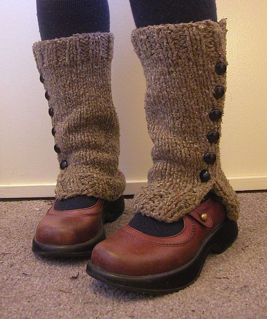Children girls' fashion. Knitted leg warmers with side buttons.