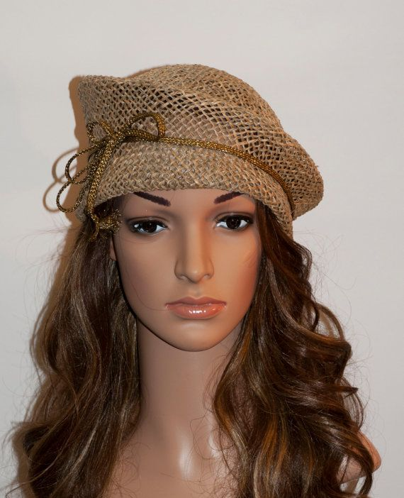 Beige (earth colour) stunning shape hat for women. Made from well beathing natural material called seagrass. Trimmed with thin matching tone dark