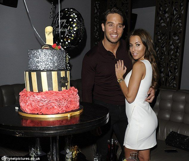Smitten: Yazmin Oukhellou and James 'Lockie' Lock proved they were still going strong, puckering up as they celebrated the brunette beauty's 24th birthday at the Escedra Lounge Bar in Chelmsford, Essex on Friday night