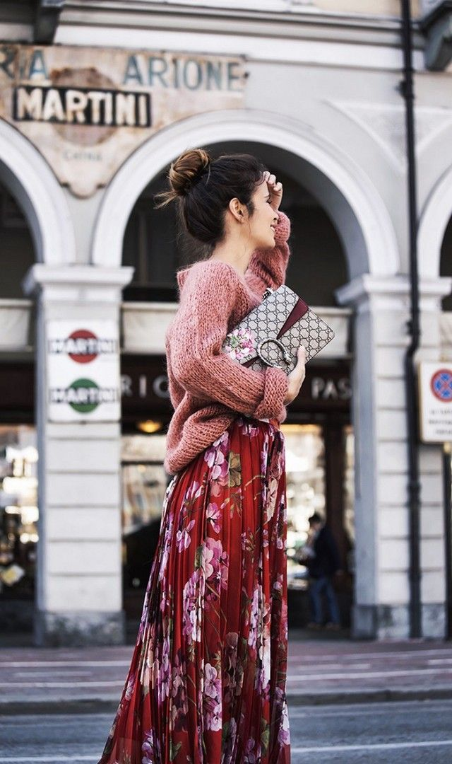 Gucci floral pleated skirt, loose knit sweater, and Gucci Dionysus clutch