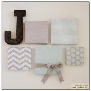 Very clever wall hanging using shoe box lids covered in scrapbook paper.