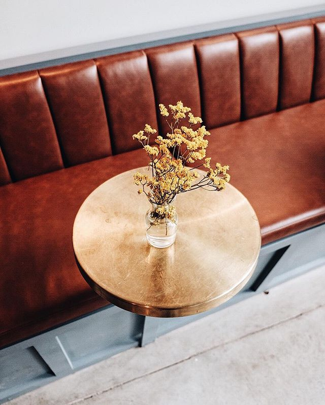 bar seating | banquette seating | brass cocktail table