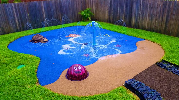 Texas backyard water park.  We installed this spray park for a very special girl that loves Finding Nemo, she has Nemo, Dory and Starfish in the ocean part of the splash pad and then the beach area has a Happy Clam spray feature along with Crush the Sea Turtle and the Water Palm feature.