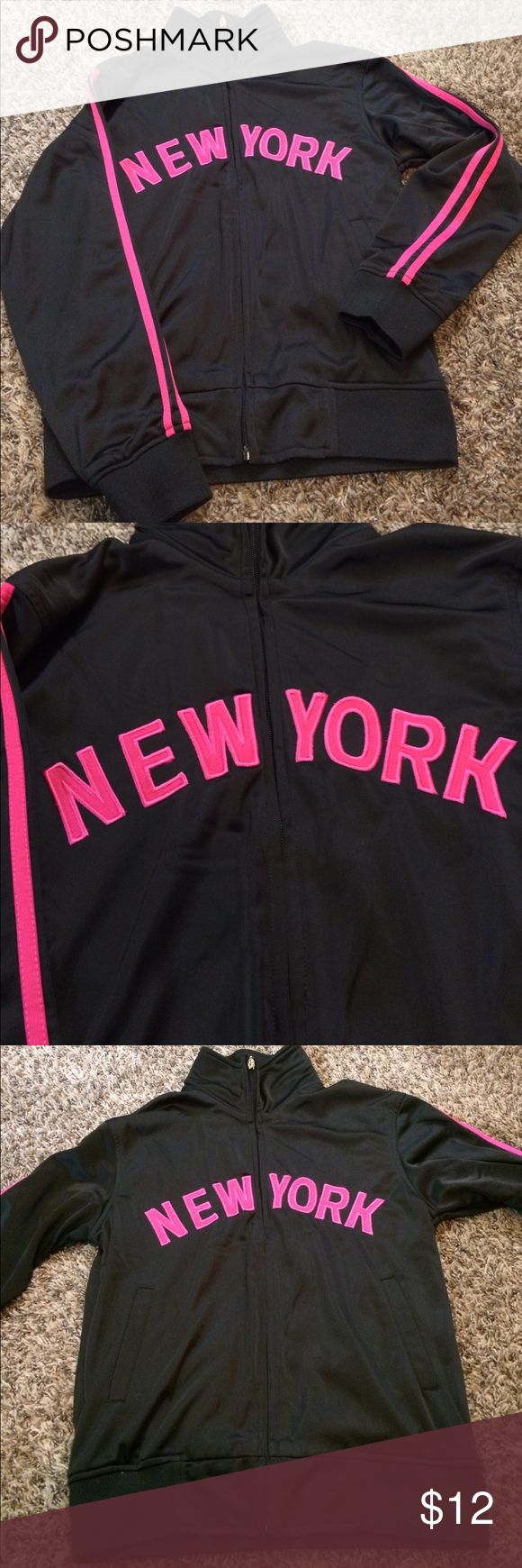 New York black athletic jacket Thicker material black athletic jacket with NEW YORK across the chest in hot pink, 2 hot pink stripes down the sleeves and NYC at top of back in hot pink. No signs of wear! Excellent condition! Bundle for further discounts! Futbol Jackets & Coats