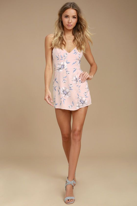Transform into a blooming beauty by slipping on the Magical Meadow Blush Pink Floral Print Skort Dress! Cream, blue, and purple floral print woven fabric, shapes a princess-seamed, triangle bodice supported by adjustable straps. Attached shorts are hidden by a wrapping mini skirt. Hidden back zipper/clasp.