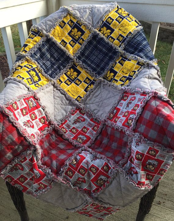 WELCOME TO OUR LISTING FOR this adorable HOUSE DIVIDED baby/toddler quilt! Throw size available too for the adult fan... Just contact us! Ohio State/Michigan baby/toddler quilt is ready to ship! We can make this quilt in any COLLEGE or NFL fabric... Girly or for your little man! Each one is custom designed so the skys the limit on design! Contact us with your idea or let us go wild at the fabric store! (As long as the licensed fabric is available) This Football themed blanke...