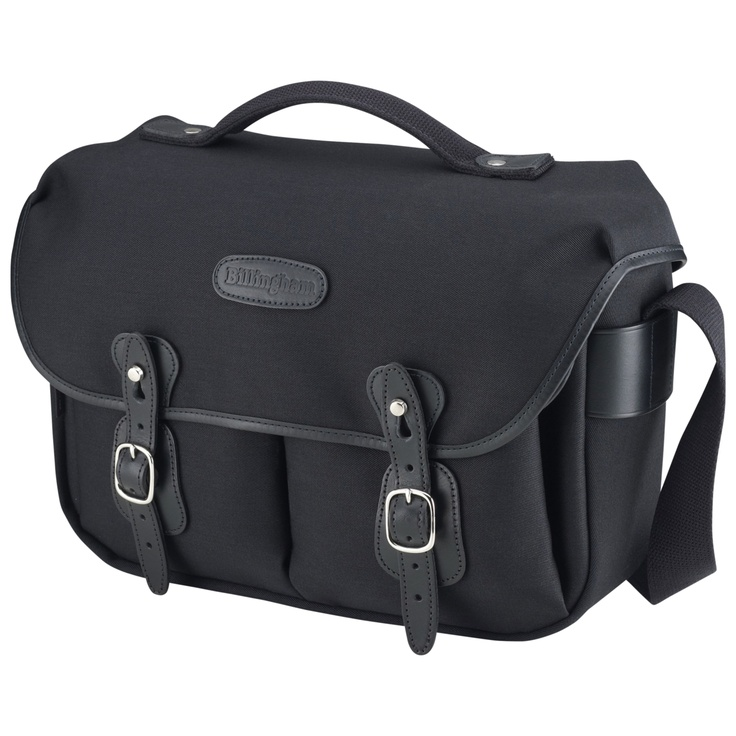 £133.29 Billingham Hadley Pro Shoulder Bag - Black & Black. Based on the immensly popular Hadley Original, the Hadley Pro has extra features; a carrying handle, a weatherproof zippered back pocket and the facility to accept AVEA pouches. The camera insert is removeable so one day it can be a roomy, well-equipped camera bag; the next it can double as a business case or a slightly posh beach bag. The Hadley Pro will accomodate A4 files and a small laptop computer.