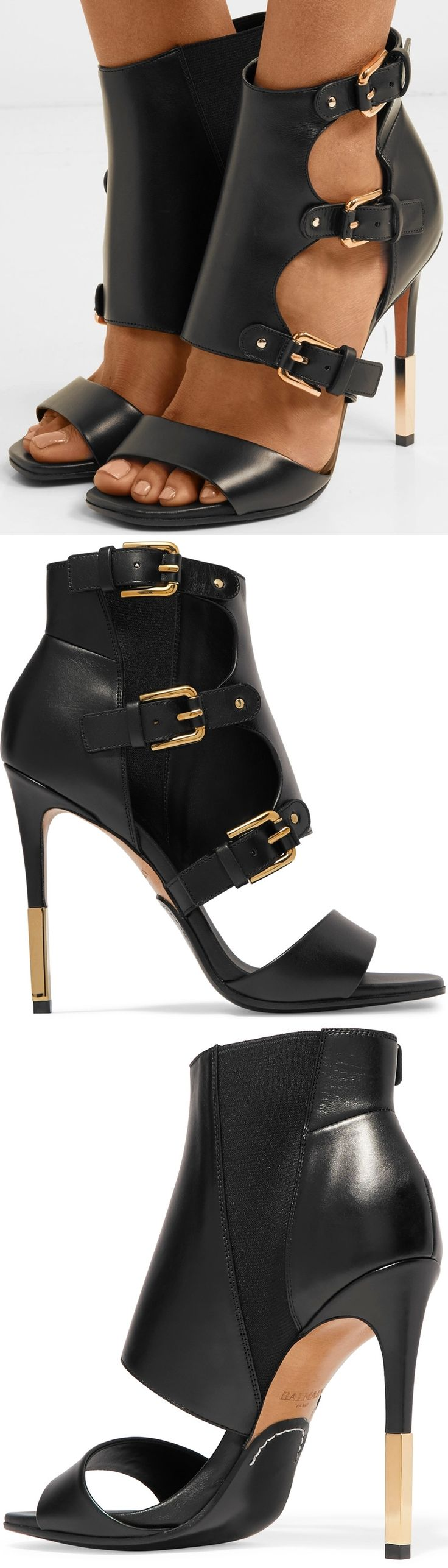 Balmain's 'Alienor' sandals are updated for fall with a trio of buckles and a polished gold tip on the heel. They've been made in Italy from smooth black leather and have flexible elasticated panels at the sides.