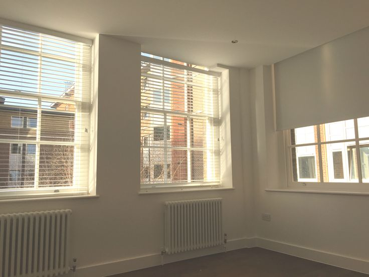 Wood venetian blinds in pure white colour fitted to yoga studio in London | Blinds for sash windows | Blackout roller blind fitted to side window | Modern blinds | Wooden slat blinds | Commercial blinds | Made to measure