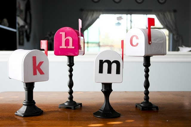 I heart this. Take thrift store candlesticks, and mini mail boxes from Micheals, add each child's initial and you have valentines boxes for love notes for the whole month! So fun!