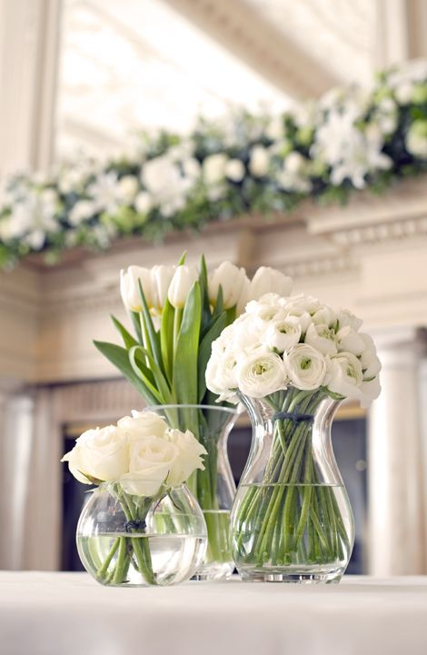 White Wedding Centerpiece: White Ranunculus, White Roses, & White Tulips
