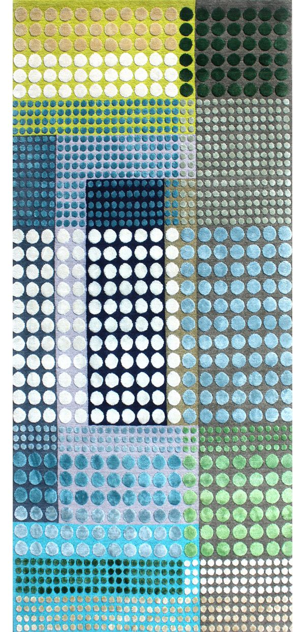 British designer Margo Selby seems to be taking the textile world by storm these days with her graphic layered dot designs