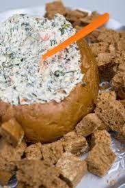trempette artichaut dans un pain - -1 boite de coeur d'artichauts hachés -1 tasse d'épinards frais hachés -1/2 tasse de crème sure -1/4 de tasse de mayo -1/2 tasse de cheddar fort -1/2 tasse de fromage à la crème -1 c. à. soupe de citron -Sel-Poivre -Parmesan au gout -1 miche de pain  Mélangez  les ingrédients. Découpez un grand cercle sur le dessus de la miche de pain et videz la de sa mie. ( en faire les croutons) Remplir la mie du mélange.Au four pendant environ 15 minutes à 350,