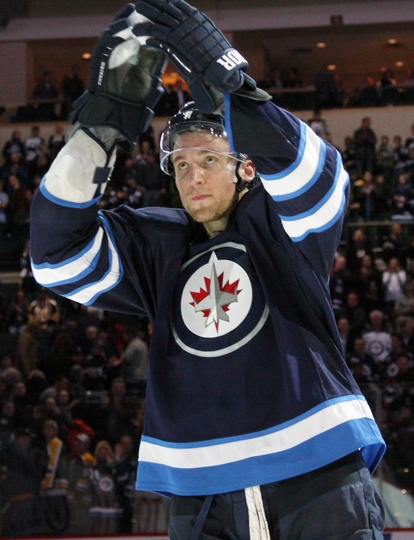 Blake Wheeler #26 of the Winnipeg Jets shows his appreciation to the home fans after receiving second star honors following a 3-1 victory over the Boston Bruins at the MTS Centre on March 19, 2013 in Winnipeg, Manitoba, Canada. (Photo by Jonathan Kozub/NHLI via Getty Images)