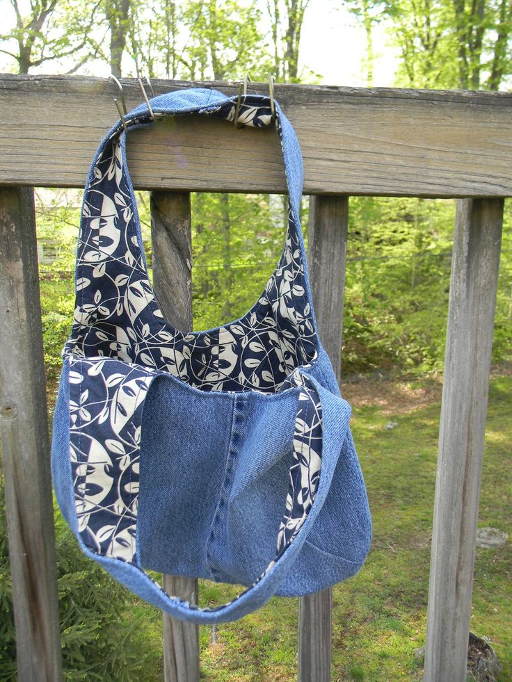 I crafted this bag from a free downloadable pattern, using old denim jeans and quilting remnants. It's hanging by one strap here to better display the lining. Learned a lot from this first effort; many more to come!