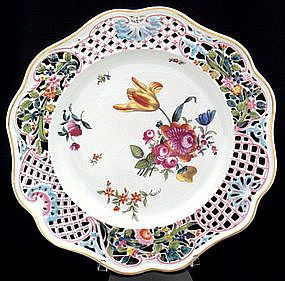 Antique~Herend~Meissen style plate~The porcelain is reticulated in an intricate pattern very similar to plates made at the Meissen factory~There are fan designs molded into the porcelain~There is gold trim around the rim~Produced in Hungary by Herend~Circa Before 1890
