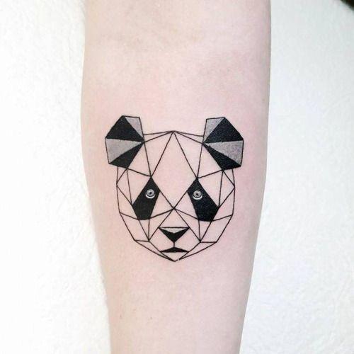 Polygonal panda bear tattoo on the right inner forearm. Tattoo...