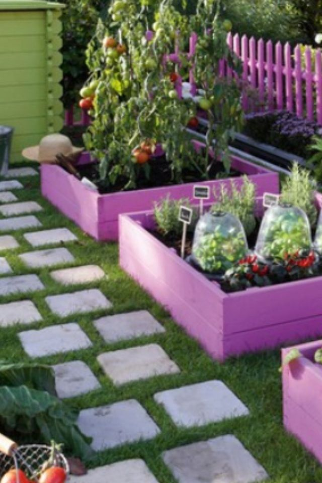 Fun square foot gardening idea using bright colors.