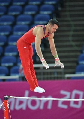 Team USA's Danell Leyva warms up his high bar routine during the gymnastics Olympic podium training in London.