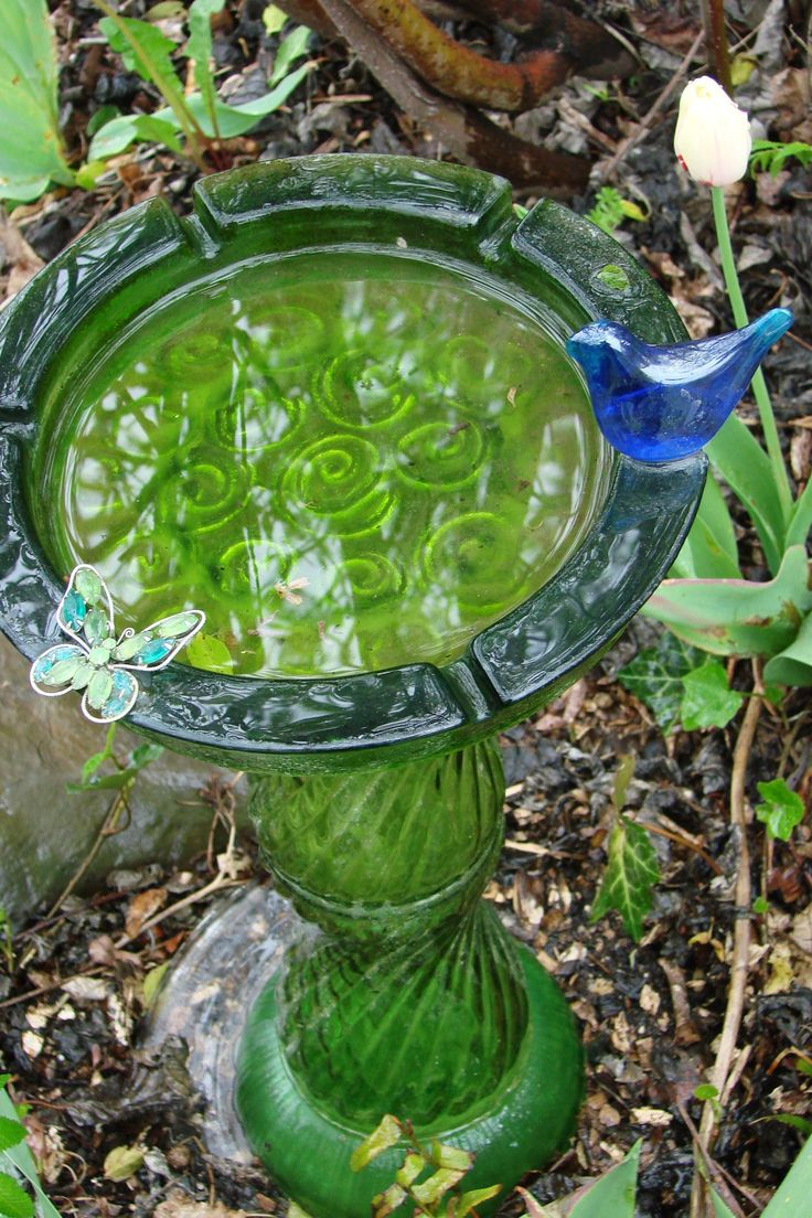 From Flea Market Gardens - Take 2 green glass vases, 1 green bowl, a microwave glass turntable for a base & a very heavy duty ashtray ...use GE Silicone II for Doors & Windows to glue. Of course, like many FMGing'ers, the 'fun' is in the 'hunt' ... so find a decoration...a glass bluebird & a jeweled butterfly pin.