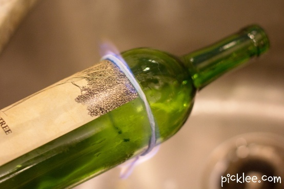Tie string around bottle, slide off and soak in acetone for 10 secs, slide back on, light on fire, as soon as fire goes out, submerge on ice cold water. how to break a wine bottle...