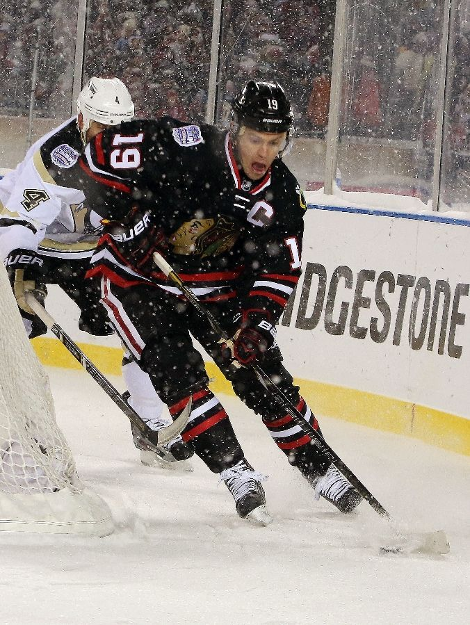 CHICAGO, IL - MARCH 1: Jonathan Toews #19 of the Chicago Blackhawks handles the puck in the 2014 Coors Light NHL Stadium Series game against the Pittsburgh Penguins at Soldier Field on March 1, 2014 in Chicago, Illinois. (Photo by Tasos Katopodis /Getty Images) #toewsface
