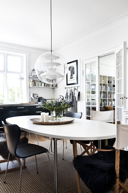 White dining table with black chairs.