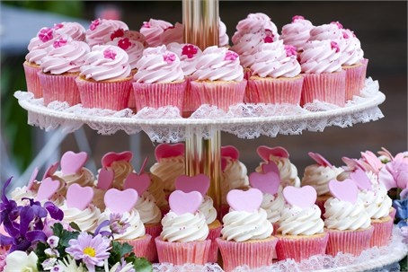 Pink wedding cupcakes with heart and flower detailing