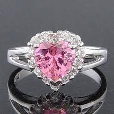 sailor moon ring - so my engagement ring looks like this, except with silver around the heart and the heart jewel is turquoise/blue. :P