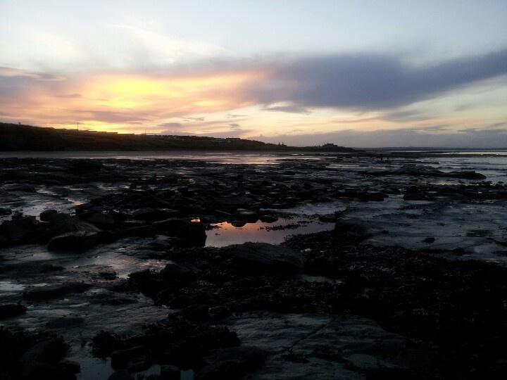 On the rocks while the sun was setting at Cresswell towers.