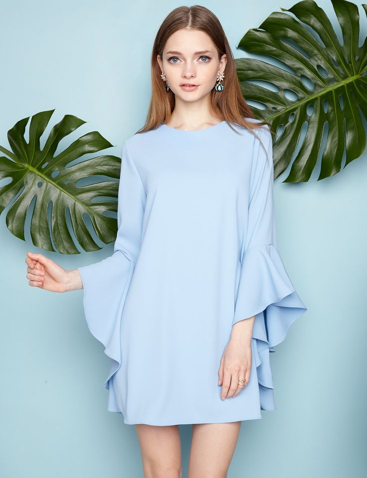 Cute light blue babydoll dress with ruffled cascade bell sleeves. Lined with zip…