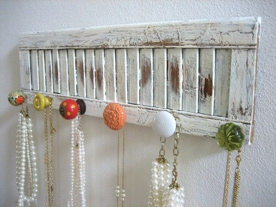 A different way to organize your jewelry - with an old shutter instead of driftwood.