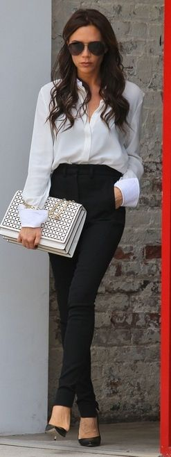 statement carryall + tucked in white blouse + black high-waisted pants