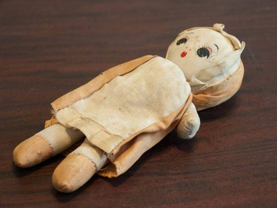 This is an antique Cloth doll, hand painted and Handmade. I believe it was made between the 1930s and 40s. It is in very good condition; there is