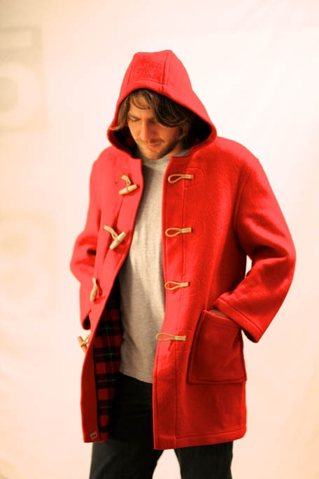 Duffle Coat from Shappere. It is a Red woolen paddington bear duffle coat. It costs $150.00