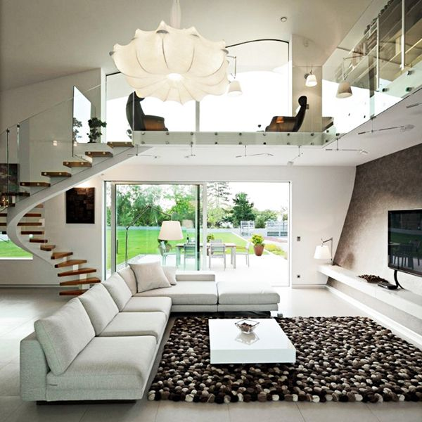 A cute, bright living room!!! I love the stairs! (: