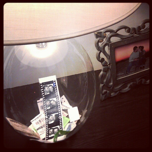 admit two :)  using a clear lamp vase to display movie/snowboarding/attraction tickets and etc.