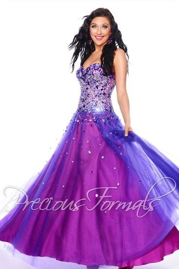 A beautiful prom dress with stunning bead work on the bodice, by Precious Formals.
