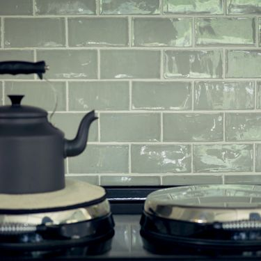 Handmade brick tiles in a range of smokey shades by Fired Earth - the Valencia is perfect for a splashback in a country, classic or painted kitchen. http://www.firedearth.com/tiles/range/valencia/mode/grid