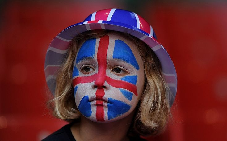 Team GB vs New Zealand: in pictures - Anticipation: a young Great Britain fan shows her support with a painted face in the stands during the women's football  Picture: PA