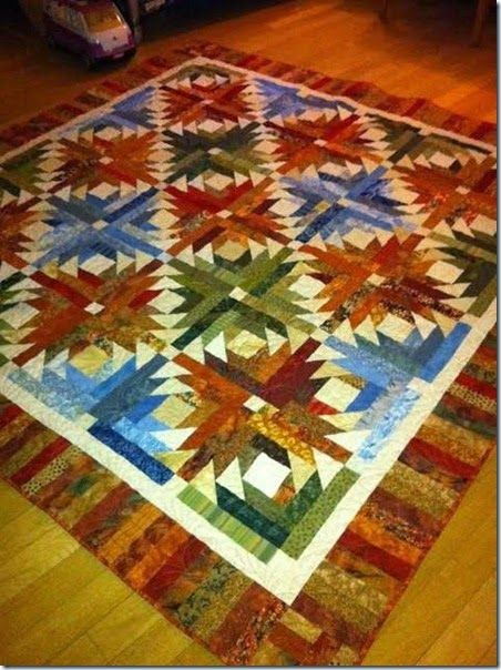 "version of Bonnie Hunter ""Pineapple Blossom"" quilt; free pattern; love the controlled color palette this quilter used"